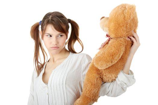Teen with teddy bear