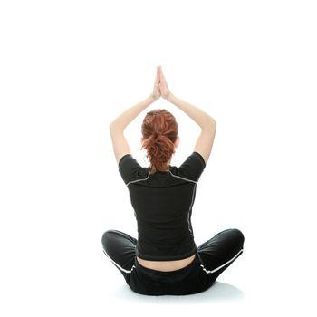 Beautiful young woman doing yoga exercise , isolated