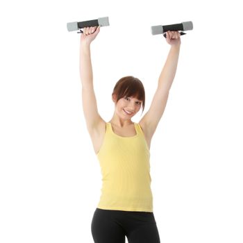 Portrait of beautiful smiling girl with dumbbells.
