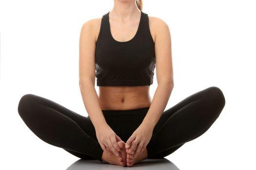 Beautiful young woman in yoga pose