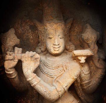 Krishna bas relief in Hindu temple. Sri Ranganathaswamy Temple.