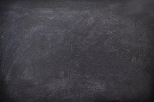 Blackboard / chalkboard texture. Empty blank black chalkboard with chalk traces