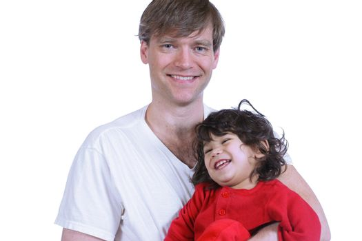 Handsome father holding his toddler, father is caucasian and son is part asian, part Scandinavian