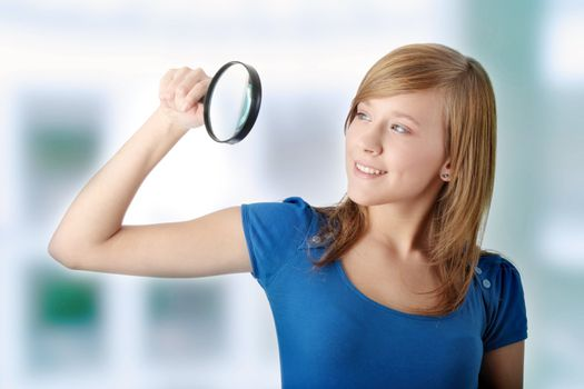 Student girl with magnifier