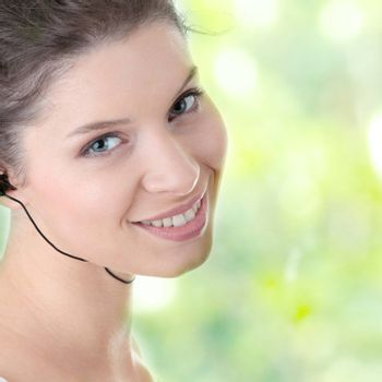 Young fitness woman with sport headphones listening music isolated