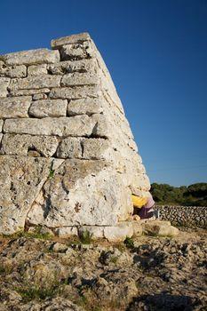 woman bottom at prehistoric monument