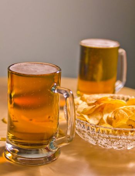 full mugs booze lager and potato chips