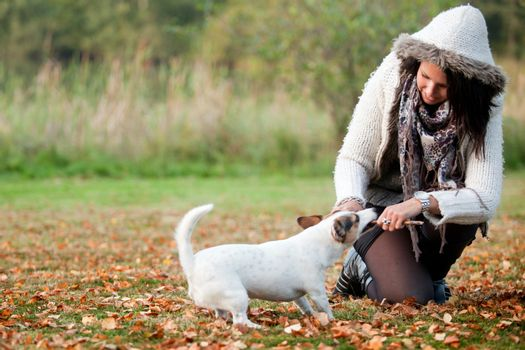 Happy girl with her Jack Russell Terrier