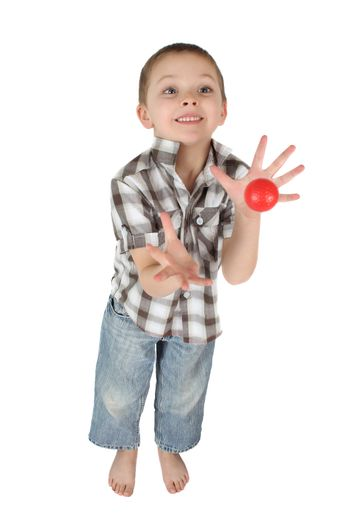 Young boy cathing a red ball on isolated background
