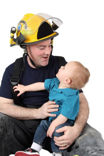 Son of a fireman looking up at him