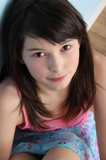 Beautiful brunette teen displaying innocent expression