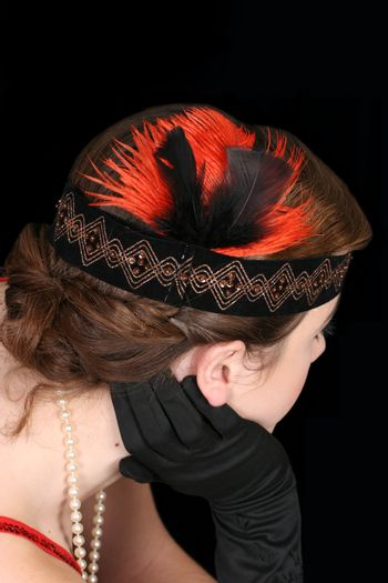 Beautiful 1920 hair style with headband and feathers