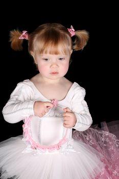 Little ballet toddler wearing a white tutu