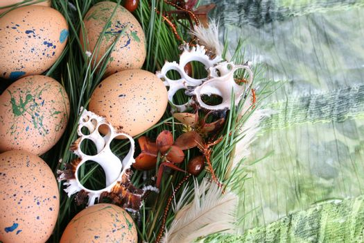 Easter wreath with eggs and decorations on green cloth