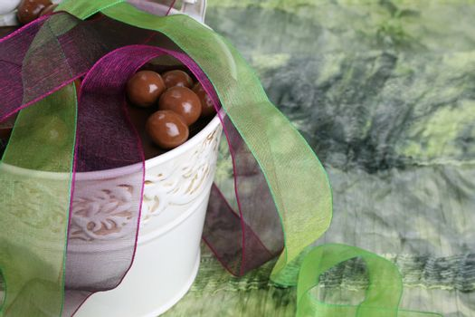 Decorative bucket with chocolate and organza ribbon