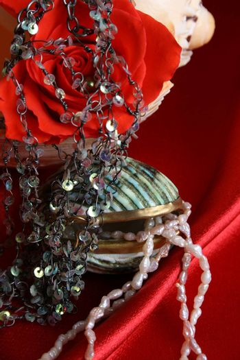 Beautiful shell container with jewellery and string of pearls
