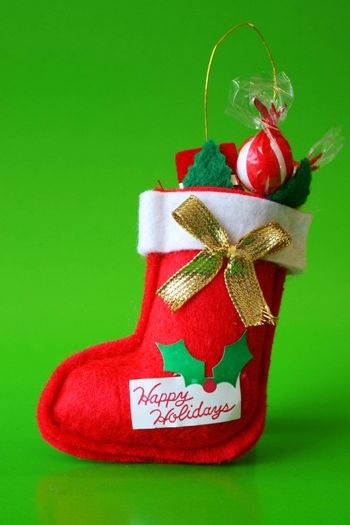Red Christmas stocking decoration filled with candy