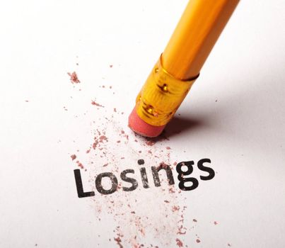 losing lose or luck concept with word and eraser on white background