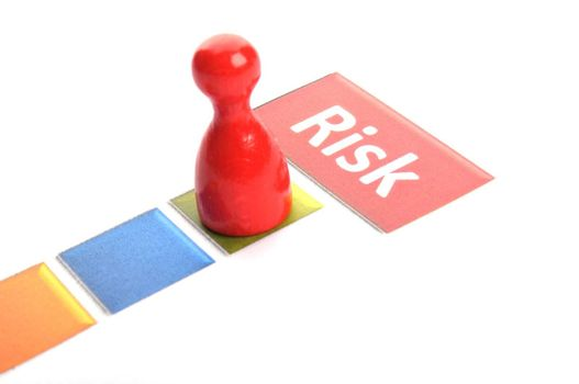 risk business concept with red pawn on white