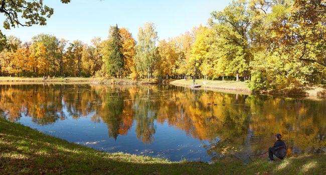 Teen Enjoys the Fall Alone near water
