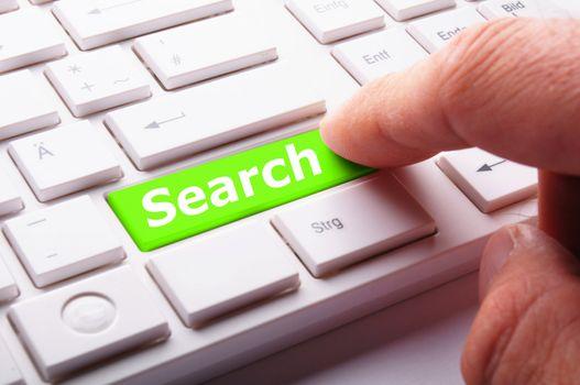 internet search engine key showing information hunt concept