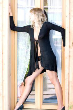 Model is in sexy pose in the doorway