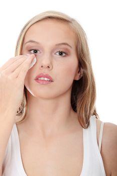 Teen woman removing makeup