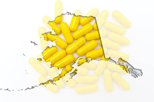 Outlined alaska map with transparent background of capsules