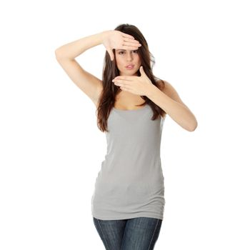 Woman framing her face with hands
