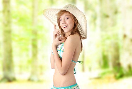 Beautifil summer teen girl in bikini outdoor