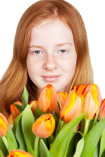 cute young girl is holding a bunch of tulips