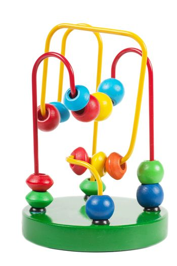 Colorful developmental toy labyrinth over white background
