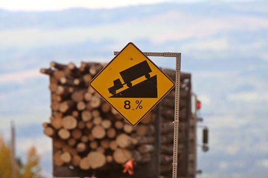 Logging truck approaching steep grade