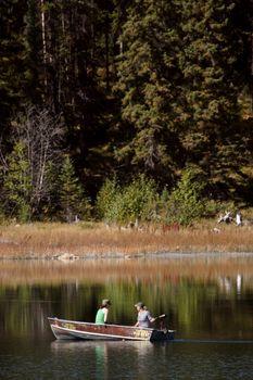Two women boating on Ressor Lake in Alberta