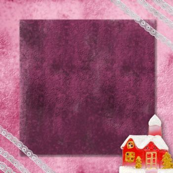 Christmas card with a red house in snow and old lace around the edges.