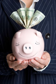 Business woman holding piggy bank
