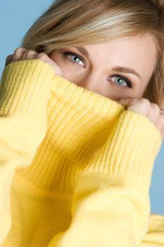 Beautiful woman wearing yellow sweater
