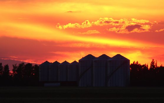 Colorful twilight and granary silhouettes