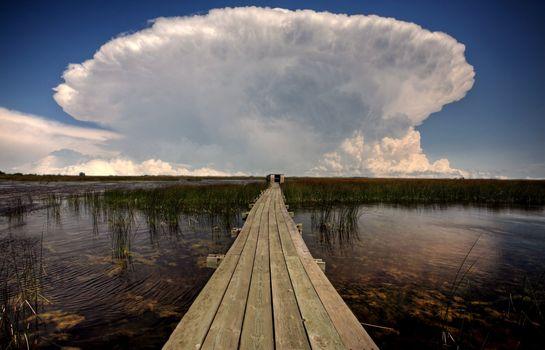Cloud formations behind waterfowl blind