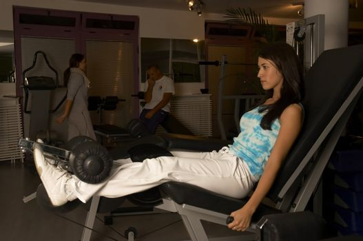 Woman practices and resting in Gym