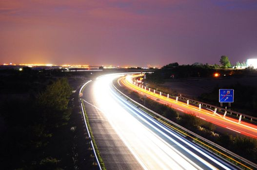 night time traffic on highway with lights showing transportation concept