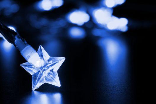 xmas or christmas holiday concept with lights and bokeh