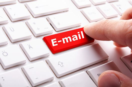 email concept with key finger and internet computer