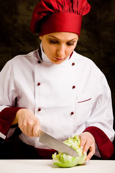 Chef cutting lettuce
