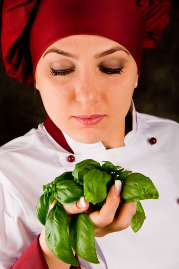 Chef is controlling basil quality