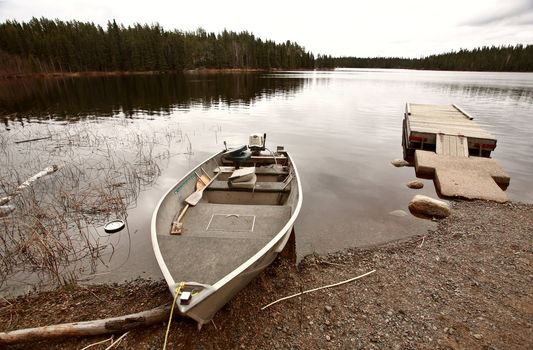beached motor boat on Northern Manitoba lake