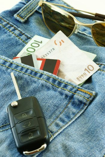conceptual shot Ready to travel with jeans, money, credit cards and car key