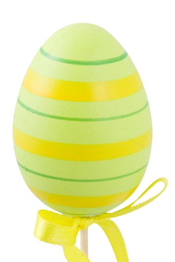 a green and yellow easter egg isolated on the white background
