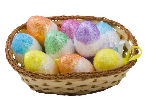 a basket of colourful easter eggs isolated on the white background