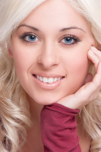 Beautiful smiling blond woman face